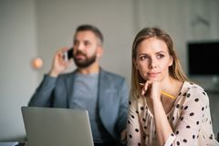 Two business people in the office. Royalty Free Stock Photography