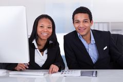 Two Business People In Office Stock Image