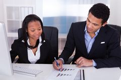Two business people in office Royalty Free Stock Photos