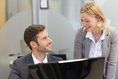 Two business people in a office, working on computer Royalty Free Stock Photos