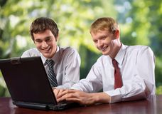 Free Two Business People On Laptop Royalty Free Stock Photography - 2300027