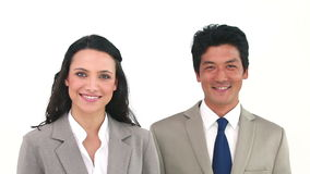 Two business people posing. Against a white background stock video