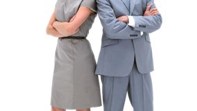 Two business people posing back to back. Against a white background stock footage