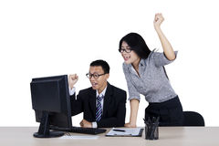 Two business people raising hands Royalty Free Stock Photography