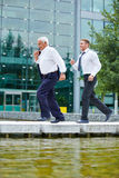 Two business people running to meeting Stock Photos