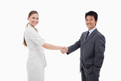 Two business people shaking hands Stock Photos