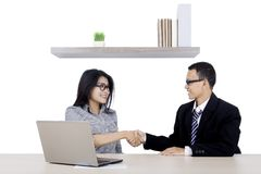 Two business people are handshake in the office Stock Images