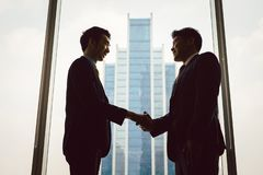 Two business people shaking hands royalty free stock images