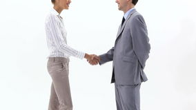 Two business people shaking hands. Video of two business people shaking hands stock footage