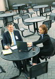 Two Business People Sit Outdoor stock photo
