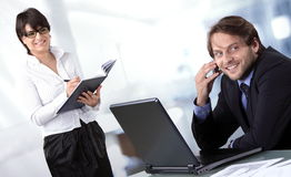 Two business people smiling. And contended with their success Stock Photos