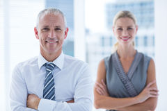 Free Two Business People Smiling At The Camera In The Office Royalty Free Stock Photos - 56483458