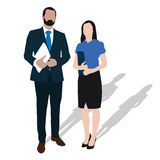 Two business people stand with documents Royalty Free Stock Image