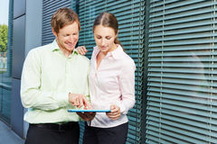 Two business people with tablet computer Royalty Free Stock Photography