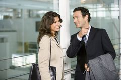 Two business people talking. Royalty Free Stock Photos