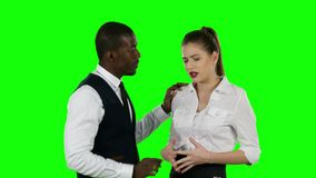 Two business people talking face to face. Green screen. Business team arguing, serious working moments, a large number of documents, working moments, green stock video footage