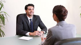Two business people talking during an interview. In an office stock footage