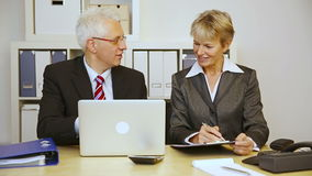 Two business people talking in office. Two elderly business people talking in the office (Full HD stock footage