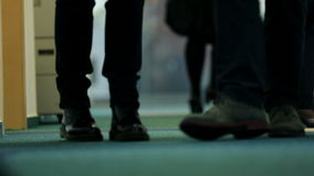 Two business people talking about problem on the way. A business people at work while walking on a hall stock footage