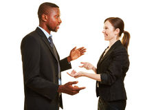 Two business people talking to each other Stock Images