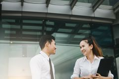 Two business people talking together at office building. royalty free stock photos