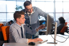 Two Business People Working With computer in office Stock Photos