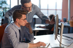 Two Business People Working With computer in office Stock Photo
