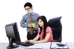Two business people using computer Royalty Free Stock Image