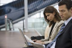 Two business people using the laptop. Royalty Free Stock Photos