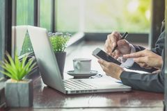 Two business people using mobile phones while working. royalty free stock photography