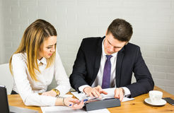 Two business people using tablet computer in office Royalty Free Stock Images