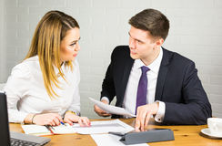Two business people using tablet computer in office Royalty Free Stock Photo