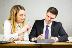 Two business people using tablet computer in office Stock Images