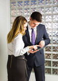Two business people using tablet computer in office Stock Photo