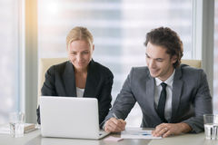 Two business people video chatting Stock Image