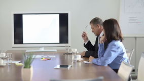 Two business people waiting in conference room. For a meeting (Full HD stock video