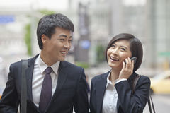 Two Business People Walking Together Stock Photography