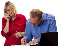 Two business people working Royalty Free Stock Image
