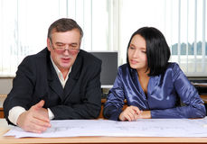 Two business people working Stock Image