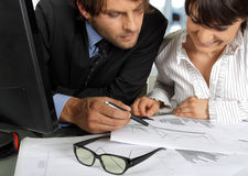 Two business people working Stock Photos
