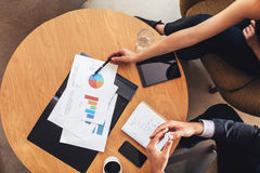 Two business people working with charts around table Royalty Free Stock Photos