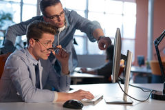 Two Business People Working With computer in office Stock Image