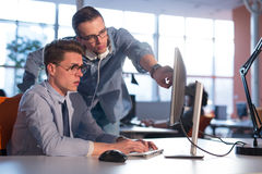 Two Business People Working With computer in office Royalty Free Stock Image