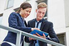 Two business people working Royalty Free Stock Photos