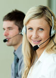 Two business people working with headsets Stock Images
