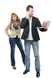 Two business people working with a laptop and phone Royalty Free Stock Images