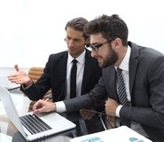 Two business people working on laptop. Photo with copy space Stock Photography
