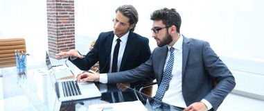 Two business people working on laptop. Royalty Free Stock Photo