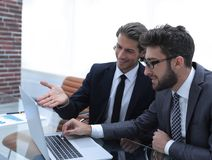 Two business people working on laptop. Photo with copy space Stock Photo