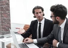 Two business people working on laptop. Photo with copy space Stock Images